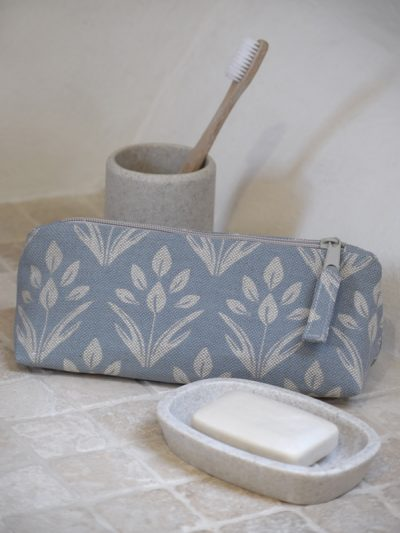 small orchid wash bag in bathroom